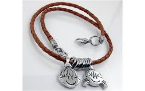 necklace charms images Necklace single string of leather and 2 charms bellezura jpg