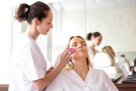 make up classes two beautician students working during make up classes stock