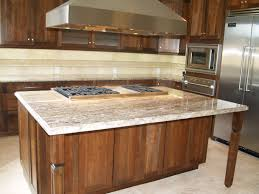 cream marble kitchen island counter top plus stove placed on the