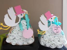 stork baby shower decorations tutorial stork carrying a package of diapers for baby