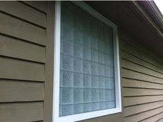 glass block basement window with air vent and dryer vent this