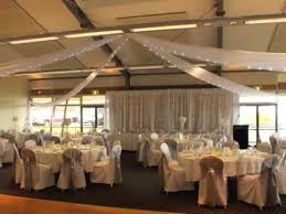 How To Drape Ceiling For Wedding Fort Scratchley Wedding With Ceiling Drapery And Fairy Lights