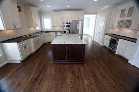 white kitchen cabinets with antique brown granite colonial white granite for a traditional kitchen with a