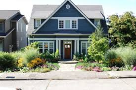 Front Curb Appeal - ornamental grass garden ideas exterior traditional with wood door