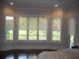 motorized solar shades halfway down bay window u0026 doors