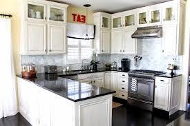black granite countertops with white cabinets white kitchen dark floors kitchens with wood backsplash ideas black