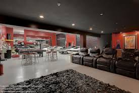 mancave garage with home theater gaming pool table upstairs