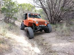 orange jeep lifted 2005 jeep rubicon lifted window tinting services for new