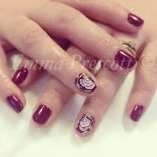 gelish and 3d acrylic nail art flowers created using nail