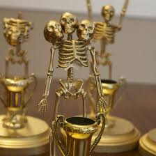 these skeleton trophies are an easy and inexpensive way to give