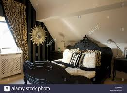 White Fur Cushions Period Style Black Bed With Faux Fur Cushions In Loft Conversion