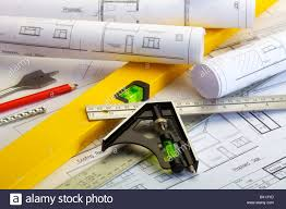 close up image of plans for a house with ruler spirit level and