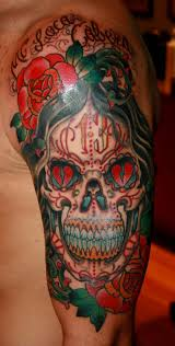 bright colored mexican skull tattoo with red roses and hearts