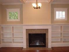 Bookshelf Around Fireplace Built In Bookshelves Around Small Square Window Google Search