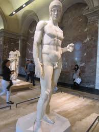 sculptures of men all over the greek section in the louvre