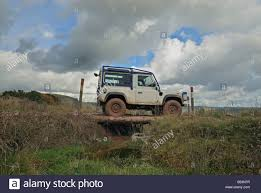 land rover defender white white land rover defender 90 equipped with an external roll cage