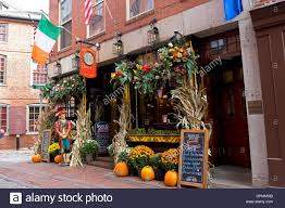 sign and halloween decorations outside the pub in boston stock