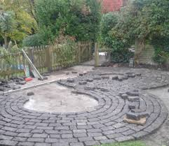 patio constructed with granite sets in a consentric pattern