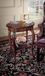 butler specialties plantation cherry oval accent table 0532024