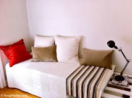 Pallet Of Laminate Flooring White Wooden Bed With White Red And Brown Pillows Plus Striped