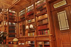 home library design uk a beautiful library wrapped in mahogany wood has a second floor