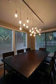 Hanging Lights For Dining Room Elegant Candle Chandeliers For The Dining Room Holly Hunt