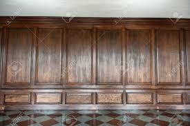 old medieval wood paneling covering a wall in a historical country