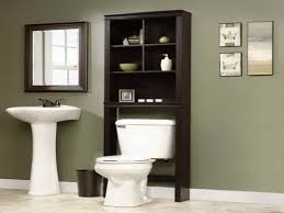 Bronze Bathroom Shelves White Pedestal Sink With Bronze Two Handle Faucet Beside Espresso