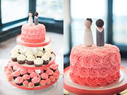 coral wedding cake with cupcakes wedding cakes in kent essex