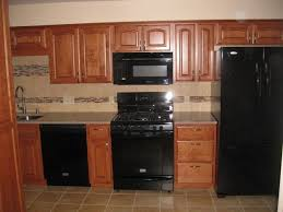 kitchens with black appliances kitchen remodel before and after