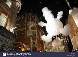 giant snowman christmas decorations in carnaby street london uk