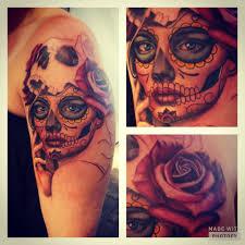 tattoo roses on shoulder sugar skull tattoo symbols on man u0027s shoulder red rose diamonds
