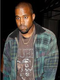 man name necklace images One proud pops kanye west wears 39 saint 39 necklace to l a lounge jpg&a