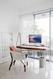 an imac computer placed on a desk that overlooks the window