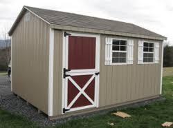 dog barn wood storage barn turned into a dog barn