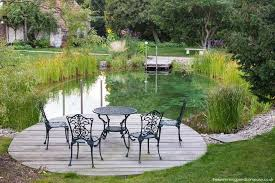 Backyard Swimming Ponds by Natural Swimming Ponds