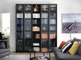 furniture home library with black wooden book cabinet using glass