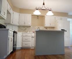factory finish kitchen cabinet painting kansas city elite also covers flaws and blocks the kitchen cabinets previous stain from coming through finally provides foundation for paint adhere