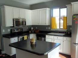 white and wood cabinets dark floors white cabinets white and wood kitchen grey and gold