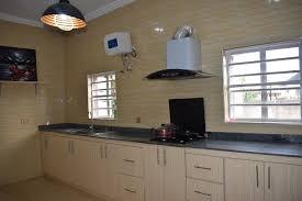 modern kitchen cabinets in nigeria kitchen yellow tiles bare windows kitchen