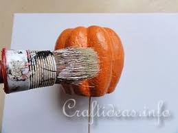 styrofoam pumpkins autumn craft and decoration pumpkins with colored sand surface
