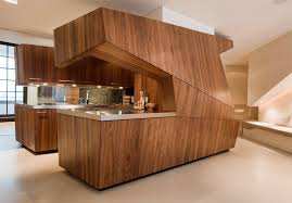 25 modern kitchens in wooden finish digsdigs modern loft with a freestanding centralized wood veneer kitchen