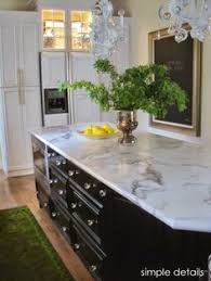 Kitchen Remodels With White Cabinets by Marble Look Laminate Countertop New March Issue Of Lowes Creative