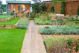 backyard deck landscaping with wooden path garden plants house