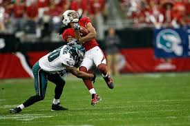 eagles safety brian dawkins tackles cardinals receiver larry