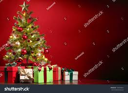 christmas tree gifts on red background stock photo 159540854