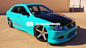 teal car white rims 2crave