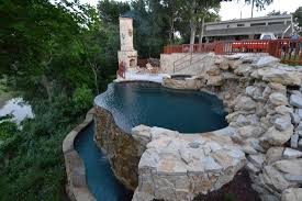 unique pool design with stacked stone system and red painted