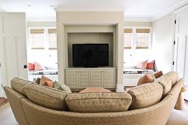 curved sectional sofa living room eclectic with area rug corner