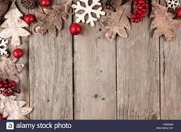 rustic christmas rustic christmas corner border with wood ornaments and berries on